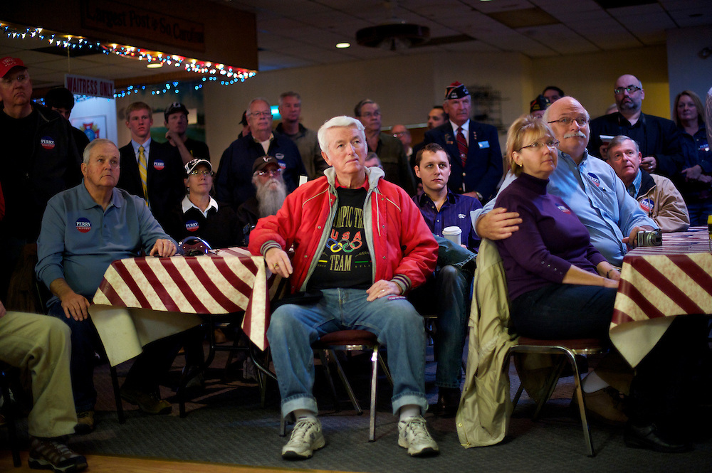 Supporters of Rick Perry listen to him speak during a town hall meeting at the VFW Post 10420 in advance of the South Carolina primary on 21 January.
