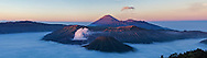 Bromo-Tengger-Semeru National Park in eastern Java. The park has three volcanoes and a large sandy caldera. Mt. Bromo is the most active of the three and consistently puffs steam and ash. <br /> (This image is a composite of three horizontal images.)