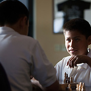 The First Tee of Monterey County opens the door to golf, as well as academic tutoring,  to many underprivileged kids of Salinas, CA, like Jose Calderon, seen playing a game of chess in the clubhouse.