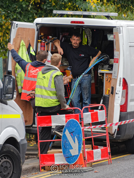 London, United Kingdom - 10 October 2015<br /> Huge drill cuts Virgin fiber cable. Thousand customers without weekend TV and internet. Severed fiber optic cables have caused up to a thousand customers of Virgin Media in Shoreditch and Hackney in London to be left without broadband internet and cable television this weekend. Engineers believe the total loss of service, which continues to be down this Saturday evening, is unlikely to be fixed until Sunday lunchtime at the earliest. The damage to a primary cable carrying 96 fiber optic cables including some belonging to the EE mobile network was caused by a huge drilling rig on a nearby construction site for a block of flats being built by Formation Construction Ltd. An engineer working on the drilling site claimed they had not 'drilled through the cable'. 'We damaged the cable' he said. He then demanded we delete images of the offending drilling rig. Technicians working on behalf of Virgin Media were working hard to replace the damaged cables. Virgin Media press office did not respond to repeated requests to speak with them for comment today.<br /> (photo by: EQUINOXFEATURES.COM)<br /> <br /> Picture Data:<br /> Photographer: Equinox Features<br /> Copyright: ©2015 Equinox Licensing Ltd. +448700 780000<br /> Contact: Equinox Features<br /> Date Taken: 20151010<br /> Time Taken: 17085500<br /> www.newspics.com
