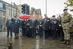 Members of the Royal British Legion, serving military and dignitaries at the war memorial during the two minutes silence of remembrance at Royal Wootton Bassett, Wiltshire.