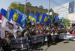 April 27, 2017 - Kiev, Ukraine - Ukrainians attend a rally organized by Ukrainian trade unions together with ''Freedom'' party in front of the Ministry of Social Policy of Ukraine in downtown Kiev, Ukraine, on 27 April 2017. Participant of rally calling for protection of labor rights, protest against the adoption of the Labor Code. (Credit Image: © Serg Glovny via ZUMA Wire)