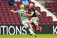 Carl Starfelt (#4) of Celtic FC fouls Liam Boyce (#10) of Heart of Midlothian FC during the Cinch SPFL Premiership match between Heart of Midlothian FC and Celtic FC at Tynecastle Park, Edinburgh, Scotland on 31 July 2021.