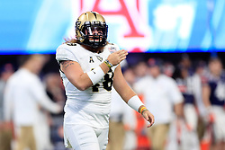 UCF Knights punter Mac Loudermilk (48) reacts to a play during the 2018 Chick-fil-A Peach Bowl NCAA football game against the Auburn Tigers on Monday, January 1, 2018 in Atlanta. (Paul Abell / Abell Images for the Chick-fil-A Peach Bowl)