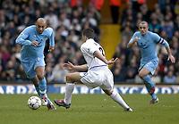 Photo. Glyn Thomas.<br /> Leeds United v Tottenham Hotspur. Premiership. <br /> Elland Road, Leeds. 10/01/2004.<br /> Spurs Stephane Dalmat (L) makes his way past Ian Harte (C) as Stephen Carr looks on.