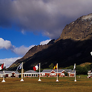 Flags of Chile and many other nations adorn the rustic, but luxurious lodge in the shadow of the towers themselves.