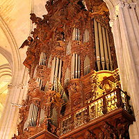 Europe, Spain, Seville. The Cathedral of Seville, Cathedral de Sevilla. Carved wood organ and pipes.