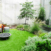 Modern Garden designed for new built condo with waterfall. Landscape Design in New yokr by Outside Space NYC