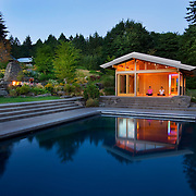 Modern Japanese meditation room reflected in exterior pool with garden surroundings