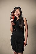 Kaying Yam, MHS senior, poses for a portrait with her viola before performing in the Milpitas Unified School District's 11th Annual Music Festival at Milpitas High School in Milpitas, California, on April 10, 2014. (Stan Olszewski/SOSKIphoto)