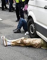 Extinction Rebellion protestors chained  under a van St Martin's Lane london photo by Krisztian Elek
