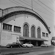"""Y-560424-11. """"Ice Coliseum being torn out. To be renovated.April 24, 1956"""" Ice Arena. NW 20th & Marshall."""
