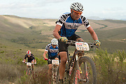 Shan Wilson of team Definitive Bikes leads his partner Adrian Enthoven during stage 3 of the 2014 Absa Cape Epic Mountain Bike stage race held from Arabella Wines in Robertson to The Oaks Estate in Greyton, South Africa on the 26 March 2014<br /> <br /> Photo by Greg Beadle/Cape Epic/SPORTZPICS