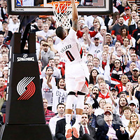 25 April 2016: Portland Trail Blazers guard Damian Lillard (0) goes for the dunk during the Portland Trail Blazers 98-84 victory over the Los Angeles Clippers, during Game Four of the Western Conference Quarterfinals of the NBA Playoffs at the Moda Center, Portland, Oregon, USA.