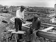 Carna. Galway Boat Bulding with the Cloherty family 14th May 1959  - 86 year old Peter Clogherty gives his son Peter the benefit of his years of experience.<br /> Carna. Saoirseacht Bád le Clann Uí Chlochartaigh, 14ú Bealtaine 1959. Peadar Ó Clochartaigh (86 bliana d'aois) ag múineadh a mhac Peadar.