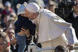 November 9, 2016 - Vatican City, Vatican - Pope Francis kisses a baby as he arrives to celebrate his Weekly General Audience in St. Peter's Square in Vatican City, Vatican on November 09, 2016. Pope Francis on Wednesday urged the faithful not to fall into indifference but to become active instruments of mercy. (Credit Image: © Giuseppe Ciccia/Pacific Press via ZUMA Wire)