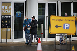 © Licensed to London News Pictures. 11/01/2021. Epsom, UK. People arrive at the vaccination centre at Epsom Racecourse in Surrey. The Epsom site is one of the new UK mass vaccination hubs with thousands of the Oxford AstraZenica jab expected to be given out everyday. Photo credit: Peter Macdiarmid/LNP