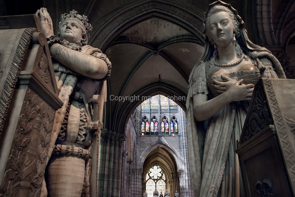 Memorial to Louis XVI (1754 - 1793) and Marie Antoinette (1755 - 1793), 1819, Marble, Edme Gaulle and Pierre Petitot, praying figures of Francois I and Claude of France with children in the distance, Abbey church of Saint Denis, Seine Saint Denis, France. Picture by Manuel Cohen