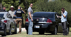 June 14, 2017 - St. Louis, MO, USA - FBI officers speak to a neighbors of James Hodgkinson on Rolling Hills Lane on Wednesday, June 14, 2017. Hodgkinson is the suspect in the shooting of a congressman and police officers in Washington, D.C. (Credit Image: © Robert Cohen/TNS via ZUMA Wire)