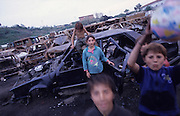 Roma Gypsies in Italy living with racism, prejudice and displacement from their homes. Many came to Italy from the Balkans in search of a new life after the violent disintegration of ex-yugoslavia. Since then they have been forced from their urban camps to live in Container camps outside cities.