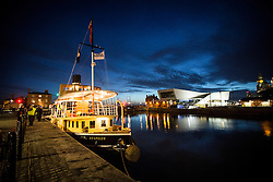 """© Licensed to London News Pictures. 04/05/2016. Birkenhead UK. Picture shows the Daniel Adamson in it's new temporary home at Canning Docks in Liverpool. The Daniel Adamson steam boat has been bought back to operational service after a £5M restoration. The coal fired steam tug is the last surviving steam powered tug built on the Mersey and is believed to be the oldest operational Mersey built ship in the world. The """"Danny"""" (originally named the Ralph Brocklebank) was built at Camel Laird ship yard in Birkenhead & launched in 1903. She worked the canal's & carried passengers across the Mersey & during WW1 had a stint working for the Royal Navy in Liverpool. The """"Danny"""" was refitted in the 30's in an art deco style. Withdrawn from service in 1984 by 2014 she was due for scrapping until Mersey tug skipper Dan Cross bought her for £1 and the campaign to save her was underway. Photo credit: Andrew McCaren/LNP ** More information available here http://tinyurl.com/jsucxaq **"""
