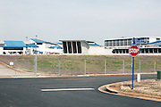 HUNTSVILLE, AL – APRIL 2, 2014: An exterior view of the Huntsville International Airport. In an attempt to reverse the trend of declining service by airlines in small airports, Huntsville International Airport attempted to implement a rebate plan that would offer incentives to some carriers for enhanced service to the midsize city. The Federal Aviation Administration cautioned that the plan could potentially violate a federal law barring interference with airline fares, routes or service levels. When the industry's largest trade group, Airlines for America, threatened to, the airport's plan was disrupted. As major airlines continue to trim service offerings in smaller, less profitable cities, airports like Huntsville International struggle to attract and maintain carriers. CREDIT: Bob Miller for The Wall Street Journal<br /> SMALLAIRPORT