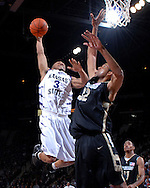 Kansas State guard Lance Harris (3) drives in for the dunk over Colorado forward Marcus King-Stockton (32), during the second half of the Wildcats 78-59 win at Bramlage Coliseum in Manhattan, Kansas, February 10, 2007.
