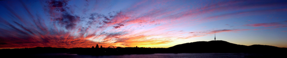 Dramatic sunset over Lake Burley Griffin, Canberra, Australia. The radio tower at right is on Black Mountain.