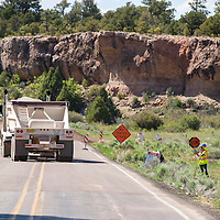 060613       Brian Leddy<br /> A flaggers directs traffic Wednesday on New Mexico Highway 400. A portion of the road is being repaved near McGaffey.