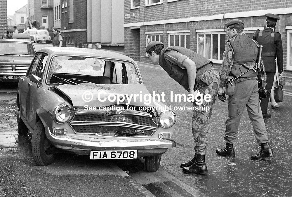 Soldiers and police examine the bullet-ridden crashed car in which a hospital porter coming off duty died at the Royal Victoria Hospital, Belfast, N Ireland, UK, 8th June 1977 in a Provisional IRA gun attack. Gerald Tucker, Belfast, N Ireland, 37 years old, Protestant, was a part-time lance corporal in the Ulster Defence Regiment. 197706080173b<br /> <br /> Copyright Image from Victor Patterson, Belfast, UK<br /> <br /> t: +44 28 9066 1296 (from Rep of Ireland 048 9066 1296)<br /> m: +44 7802 353836<br /> e: victorpattersonbelfast@gmail.com<br /> <br /> www.images4media.com<br /> <br /> Please see my full Terms and Conditions of Use at https://www.images4media.com/p/terms-conditions - it is IMPORTANT that you familiarise yourself with them.<br /> <br /> Images used online incur an additional cost. This cost should be agreed in writing in advance. Online images must be visibly watermarked i.e. © Victor Patterson or that of the named photographer within the body of the image. The original metadata must not be deleted from images used online.<br /> <br /> This image is only available for the use of the download recipient i.e. television station, newspaper, magazine, book publisher, etc, and must not be passed on to a third party. It is also downloaded on condition that each and every usage is notified within 7 days to victorpattersonbelfast@gmail.com.<br /> <br /> The right of Victor Patterson (or the named photographer) to be identified as the author is asserted in accordance with The Copyright Designs And Patents Act (1988). All moral rights are asserted.