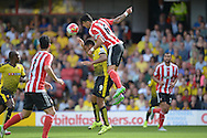 Jose Fonte, the Southampton captain leaps over Troy Deeney, the Watford captain to head the ball . Barclays Premier League, Watford v Southampton at Vicarage Road in London on Sunday 23rd August 2015.<br /> pic by John Patrick Fletcher, Andrew Orchard sports photography.