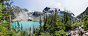 See Matier Glacier from Upper Joffre Lake, in Joffre Lakes Provincial Park of British Columbia, near Pemberton, in the Coast Range, Canada. A rough, rocky, steep hike of 10 kilometers round trip ascends (400 meters up) by a rushing stream to three beautiful turquoise lakes (colored by glacial silt reflecting green and blue sunlight). This panorama was stitched from 4 overlapping photos.
