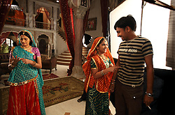 Actress Smita Bansal, 12, jokes with Assistant Director Pradip Yadav during a taping of Balika Vadhu, a television show currently being broadcast in India. Rajasthan, India on May 3, 2009.