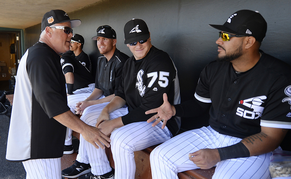 GLENDALE, ARIZONA - MARCH 06:  Manager Rick Renteria #17 of the Chicago White Sox interacts with Omar Narvaez #38 prior to the spring training game against the San Diego Padres on March 6, 2017 at Camelback Ranch in Glendale Arizona.  (Photo by Ron Vesely)   Subject:  Omar Narvaez; Rick Renteria