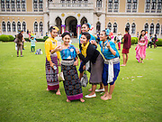 "10 JANUARY 2015 - BANGKOK, THAILAND: Thai women in traditional outfits pose for a ""selfie"" on the lawn of Government House during Children's Day. National Children's Day falls on the second Saturday of the year. Thai government agencies sponsor child friendly events and the military usually opens army bases to children, who come to play on tanks and artillery pieces. This year Thai Prime Minister General Prayuth Chan-ocha, hosted several events at Government House, the Prime Minister's office.    PHOTO BY JACK KURTZ"