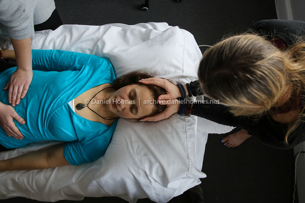 (1/27/19, HUDSON, MA) Volunteer Elis O'Shea receives some reiki at Synergy Wellness Center in Hudson on Sunday. Synergy Wellness Center offered an afternoon of free energy healing for furloughed government employees. [Daily News and Wicked Local Photo/Dan Holmes]