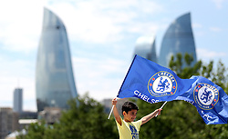 A Chelsea fan holds up a flag prior to the UEFA Europa League final at The Olympic Stadium, Baku, Azerbaijan.