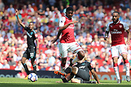 Arsenal midfielder Ainsley Maitland-Niles (30) is tackled by West Ham United defender Pablo Zabaleta (5) during the Premier League match between Arsenal and West Ham United at the Emirates Stadium, London, England on 22 April 2018. Picture by Bennett Dean.