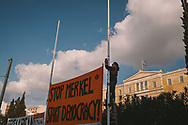 Syriza government supporters hang banners in front of the Greek parliment building in Syntagma square, Athens. The pro government rally was seen as a first by many Greeks, who are used to seeing anti government demonstrators and clashes with police.