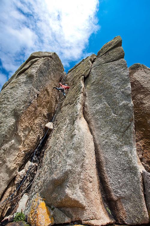 Mark Glaister climbing 'Kernyck' hard severe 4b at Cribba Head, Cornwall, England