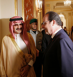 File photo - French President Francois Hollande (R) talks with Saudi business magnate and investor Prince Al-Walid ben Talal ben Abdelaziz Al Saoud before a meeting in Riyadh, Saudi Arabia on Tuesday, May 5, 2015. Hollande is the guest of honor of the 36th Gulf Cooperation Council Summit in Riyadh, where security issues in the region are going to be discussed. A new Saudi anti-corruption body has detained 11 princes, four sitting ministers and dozens of former ministers, media reports say. The detentions came hours after the new committee, headed by Crown Prince Mohammed bin Salman, was formed by royal decree. Among them is Prince Al-Walid ben Talal ben Abdelaziz Al Saoud. Photo by Christophe Ena/Pool/ABACAPRESS.COM
