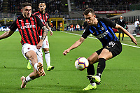 Davide Calabria of AC Milan and Ivan Perisic of Internazionale compete for the ball during the Serie A 2018/2019 football match between Fc Internazionale and AC Milan at Giuseppe Meazza stadium Allianz Stadium, Milano, October, 21, 2018 <br />  Foto Andrea Staccioli / Insidefoto