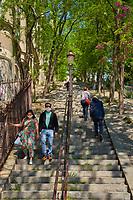 Paris , France - April 26 , 2020 :  people authorised promenade in Montmartre during the  lock down coronavirus covid-19 quarantine