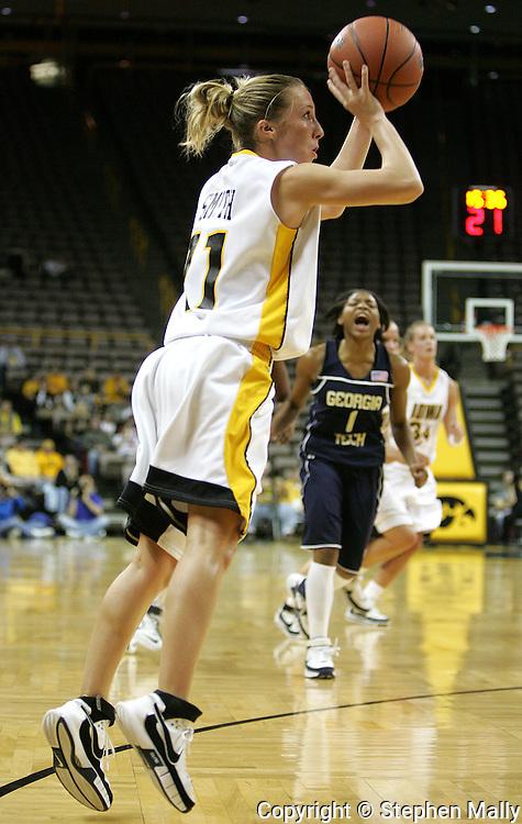 28 NOVEMBER 2007: Iowa guard Kristi Smith (11) puts up a shot in the first half of Georgia Tech's 76-57 win over Iowa in the Big Ten/ACC Challenge at Carver-Hawkeye Arena in Iowa City, Iowa on November 28, 2007.