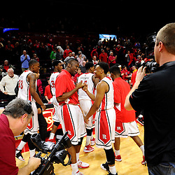 (L-R) Kerwin Okoro #3 and Myles Mack #4 of the Rutgers Scarlet Knights celebrate after Rutgers men's basketball's 71-66 victory over the Temple Owls in American Athletic Conference play on Jan. 1, 2014 at Rutgers Louis Brown Athletic Center in Piscataway, New Jersey.