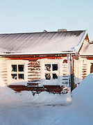 The visitor hut, covered in wind swept snow, at the top of Mount Storsteinen in Tromso, Norway