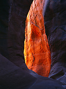 Orange glowing chamber in a slickrock slot canyon, Grand Staircase-Escalante National Monument, Utah.  (PG)