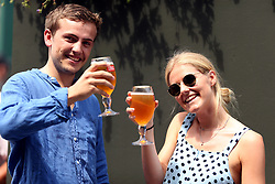 Spectators with pints of Stella Artois on day four of the Wimbledon Championships at the All England Lawn Tennis and Croquet Club, Wimbledon