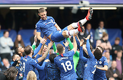Chelsea's Gary Cahill is thrown in the air during the Chelsea Lap of Appreciation during the Premier League match at Stamford Bridge, London.