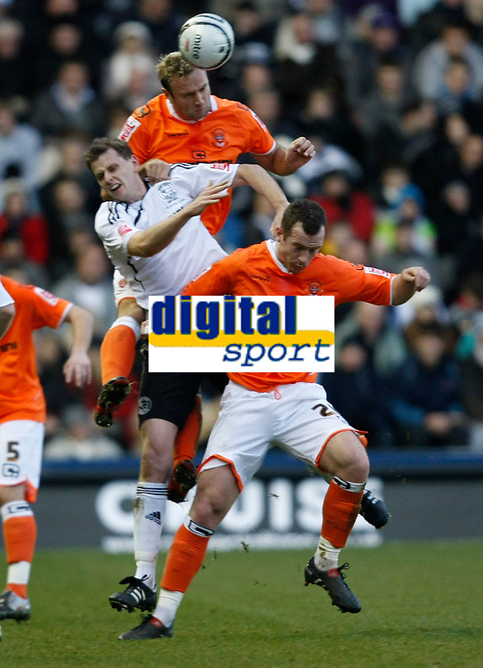 Photo: Steve Bond/Richard Lane Photography. Derby County v Blackpool. Coca-Cola Championship. 26/12/2009. Keith Southern (top), Chris Porter (middle) and Charlie Adam (lower contest a high ball